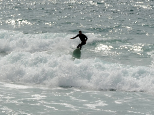 Surfing at Trebarwith Strand